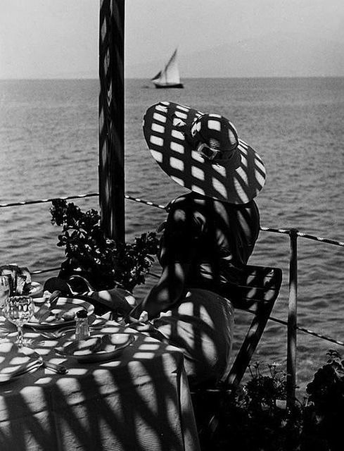 A woman in a wide brimmed summer hat looking out at the Bay of Naples, 1930s. #Italy #vintage
