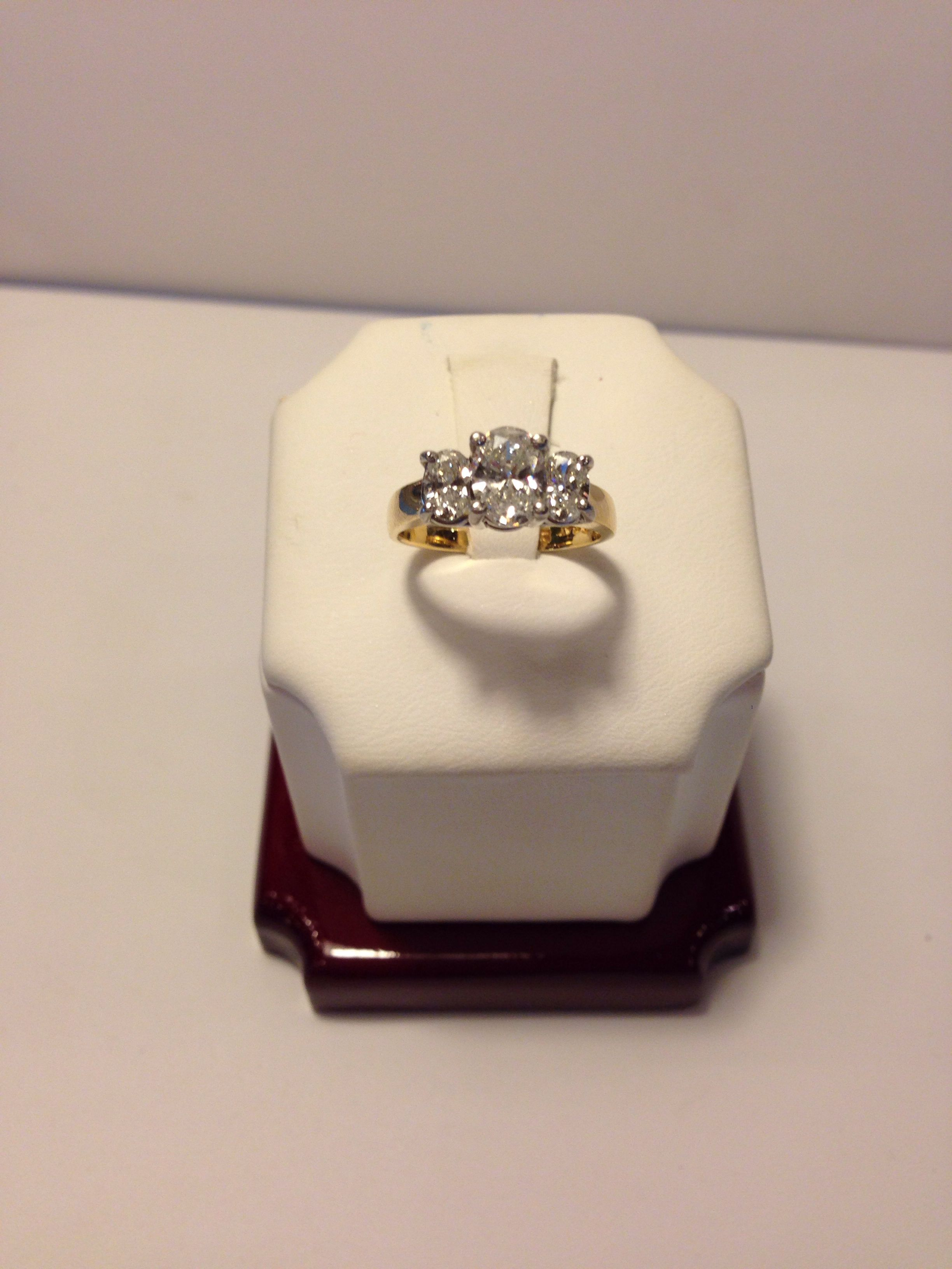 14k yellow gold Diamond Ring. Center stone approximately 60 points (slightly over a half carat)- SI2. Side stones approximately 20 points each (slightly under a half carat total)- I-H. Total approximate diamond weight- 1 carat. Only $1600!