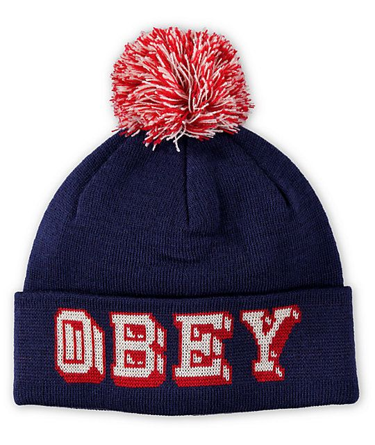 882dd68ff1b Add color to any outfit with a red and white Obey text embroidered on a  navy fold over cuff with a red and white pom on top for added fun.