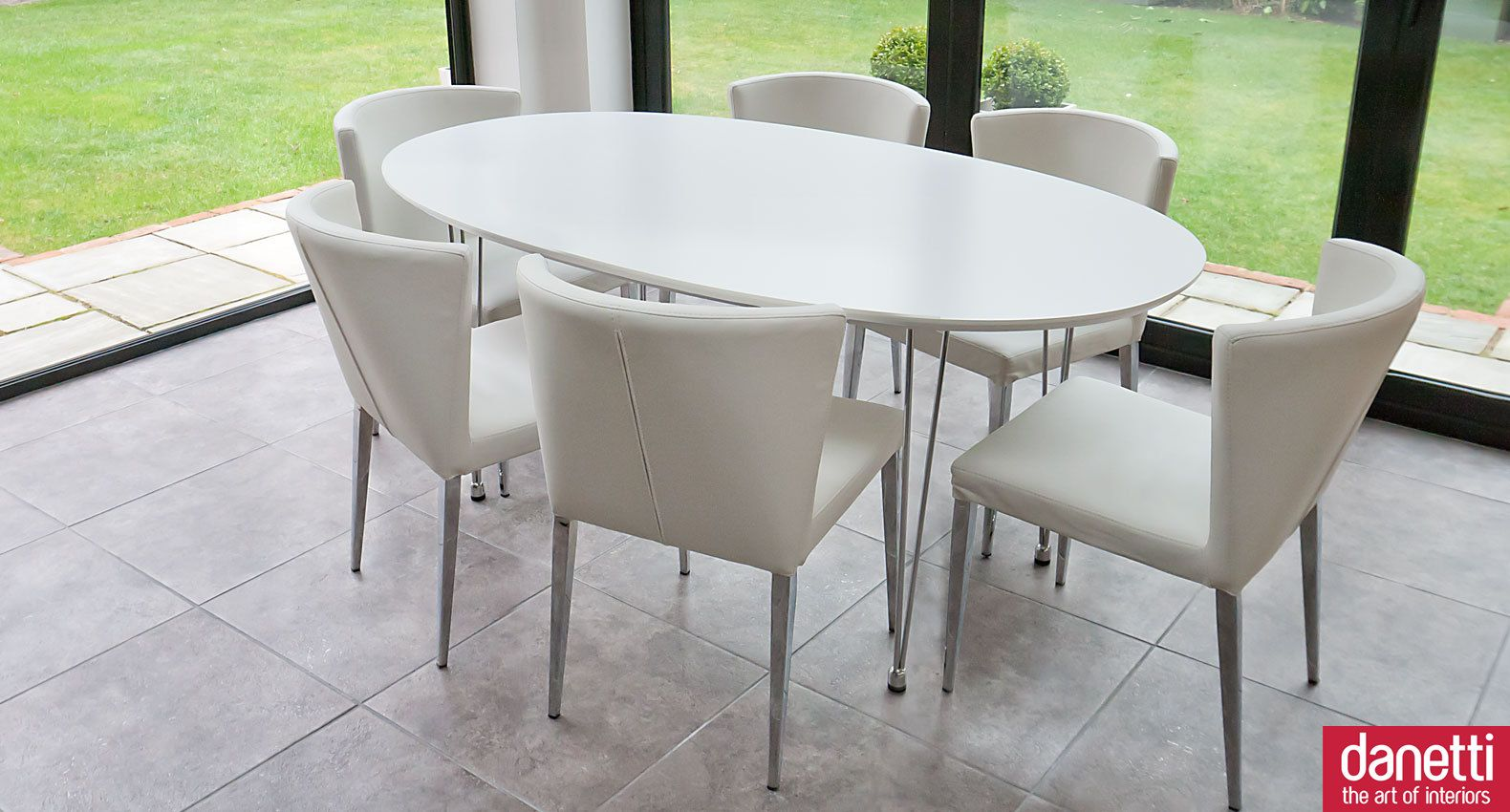 A modern curvy dining set which is new and exclusive to for White oval back dining chair
