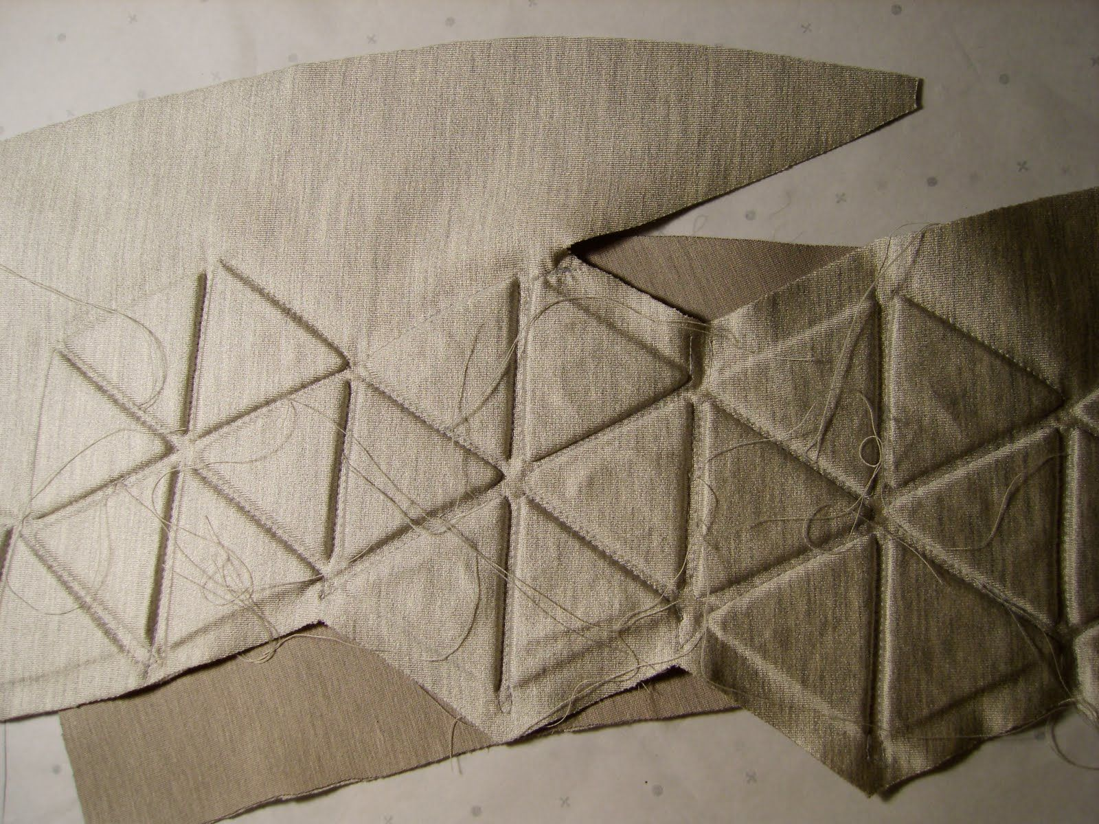 Innovative Textiles Design - 2D triangles stitched together & later folded into a geometric 3D garment; fabric manipulation for fashion // Rachel Poulter