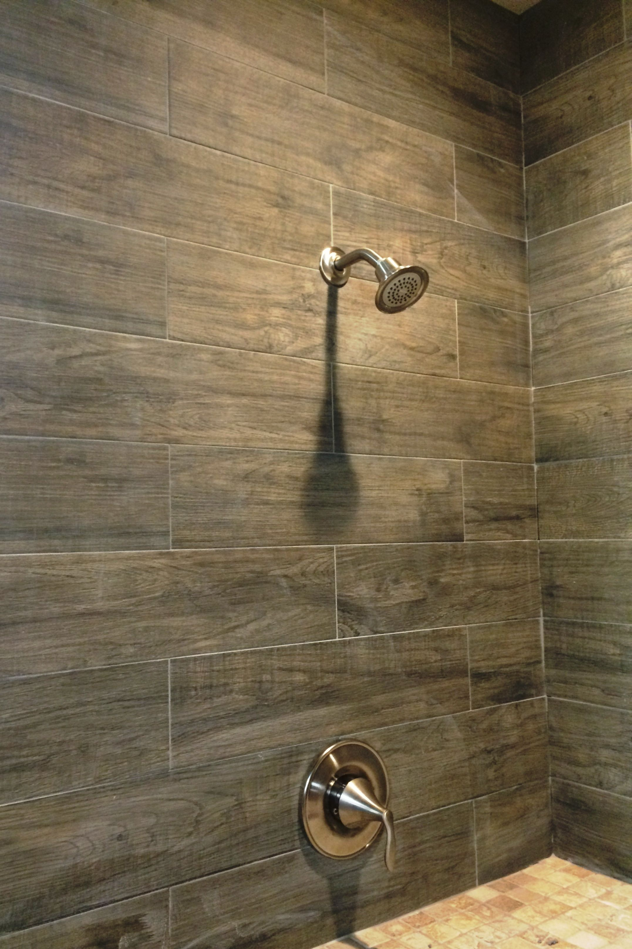 this photo features our dyrewood cinnamon faux wood tile