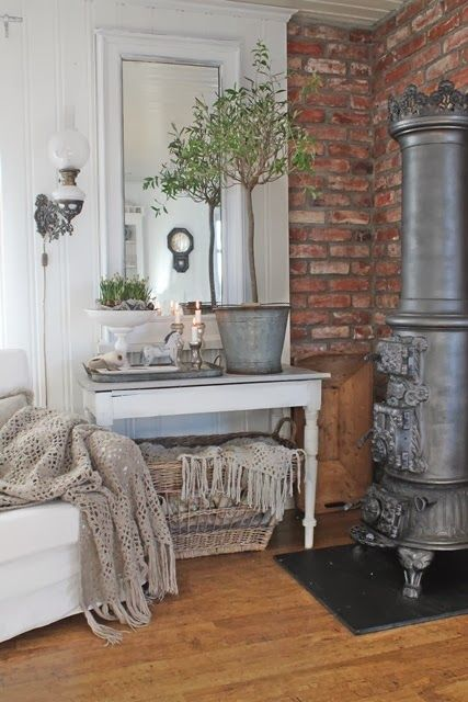 Love the chair and the table in front of the stove.  The styling of the table is fab too!  via VIBEKE DESIGN: Valgets kvaler....