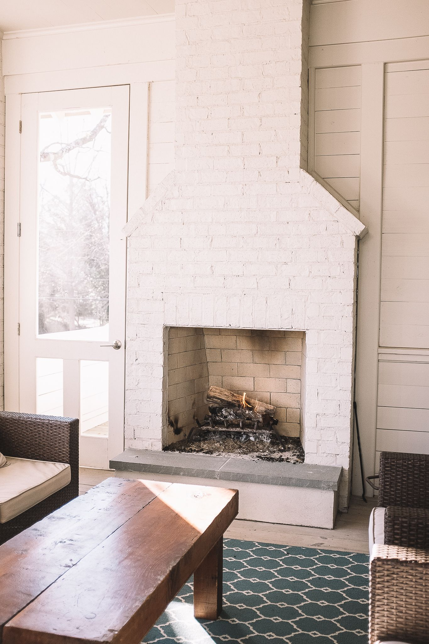 Outdoor fireplace on porch by firerock outdoor fireplaces