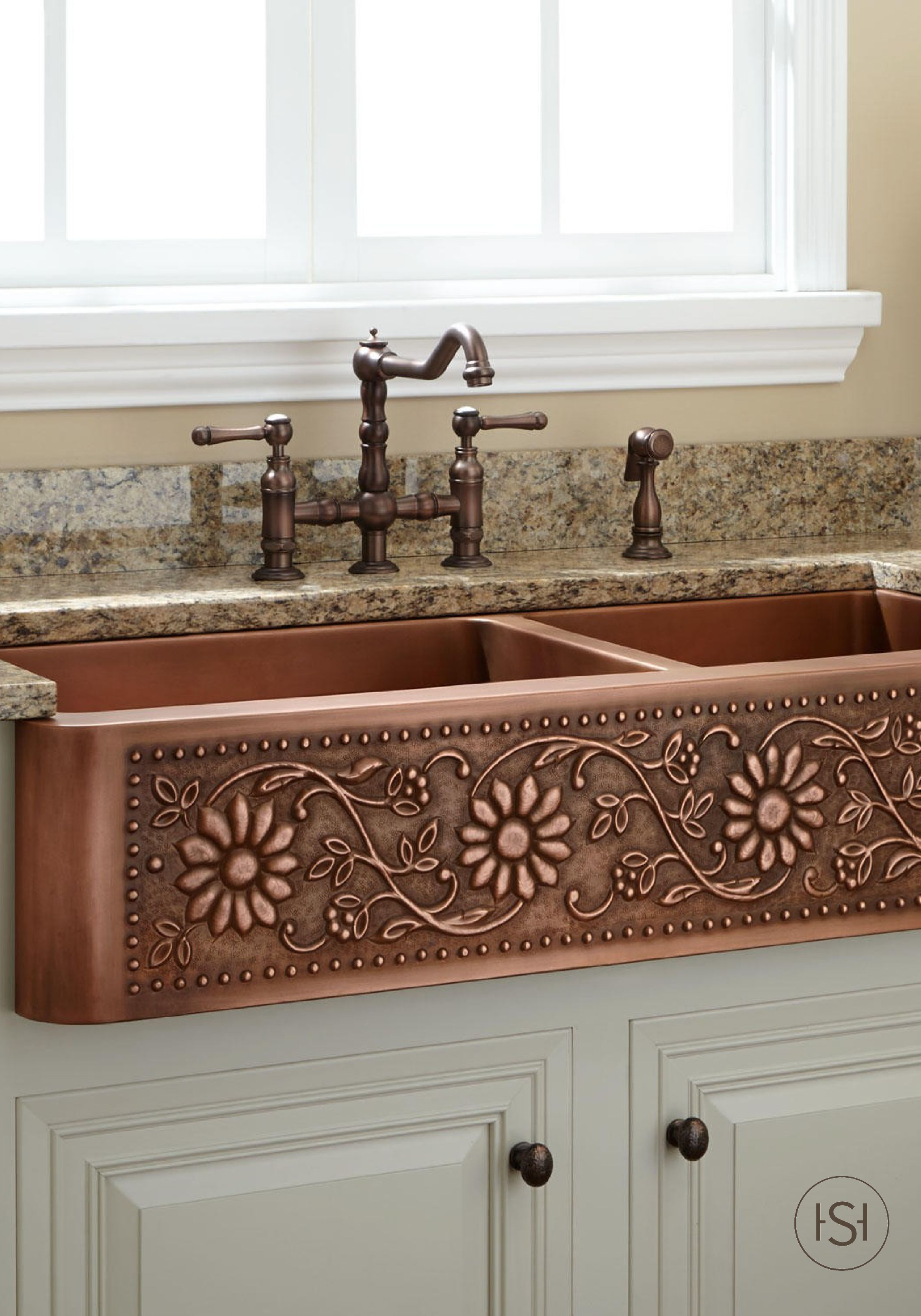 Bring warmth and style to your cottage-chic kitchen with a copper farmhouse sink with a sunflower design. Start planning your new kitchen renovation by re-pinning this lovely and unique sink.