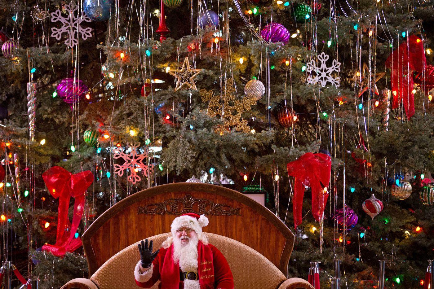 Santa Claus Waves At Kids As Visitors Enjoy Holiday Spirit At The Durham Museum S Christmas At Union Station Large Christmas Tree Christmas Tree Holiday Spirit