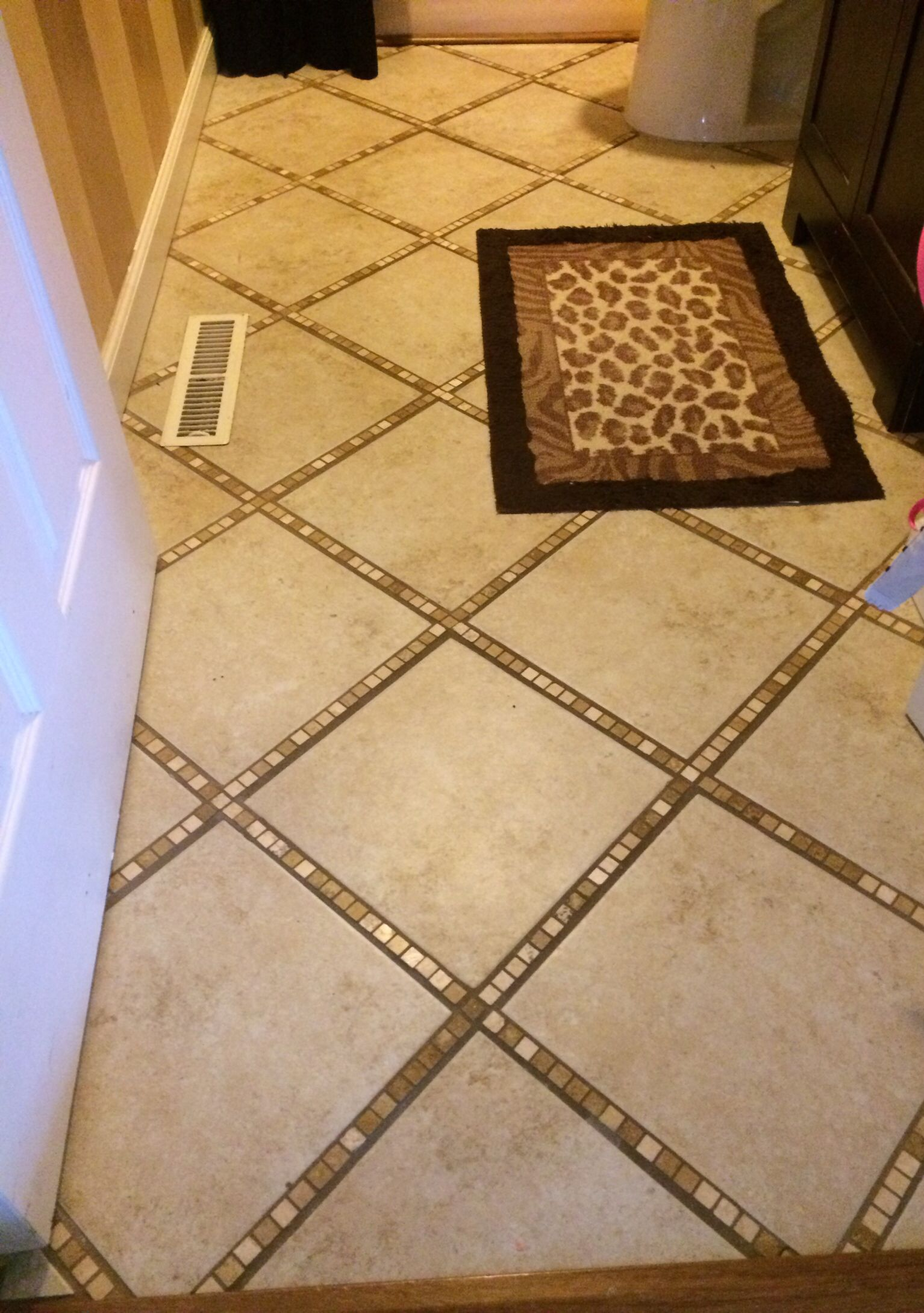 I Tiled My Bathroom Floor In A Diagonal Pattern Using Tiny Mosaic Square Travertine Tiles In The Grout Linees Between The Larger X Tiles