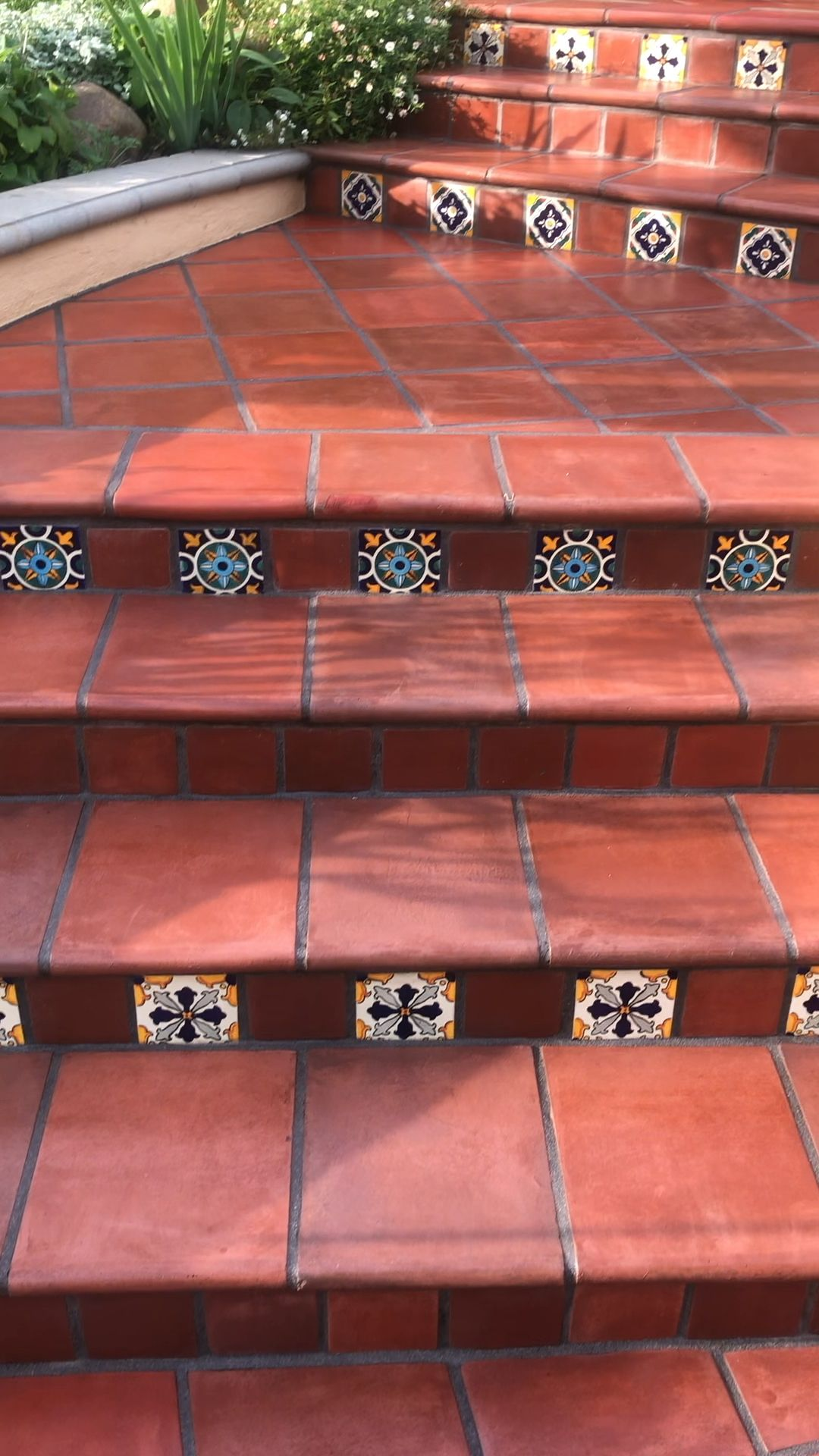 This amazing terracotta tile staircase was I  Santa Monica and was sealed with the shiny topical coating that was failing turning white and peeling  We fully stripped and removed all that old sealer and resealed with a color enhancing penetrating sealer, what do you think of this color  is part of Saltillo tile -
