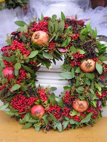 "Photo of Natural shades of red. 24 ""wreath with seeds eucalyptus, pomegranates and rosehip or fla …"