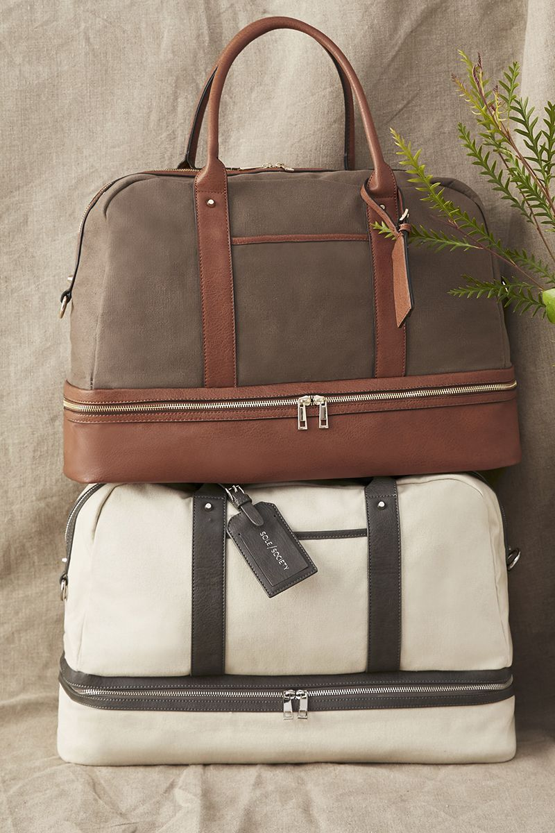 half price official store watch The perfect carry-on travel bag with a bottom compartment ...