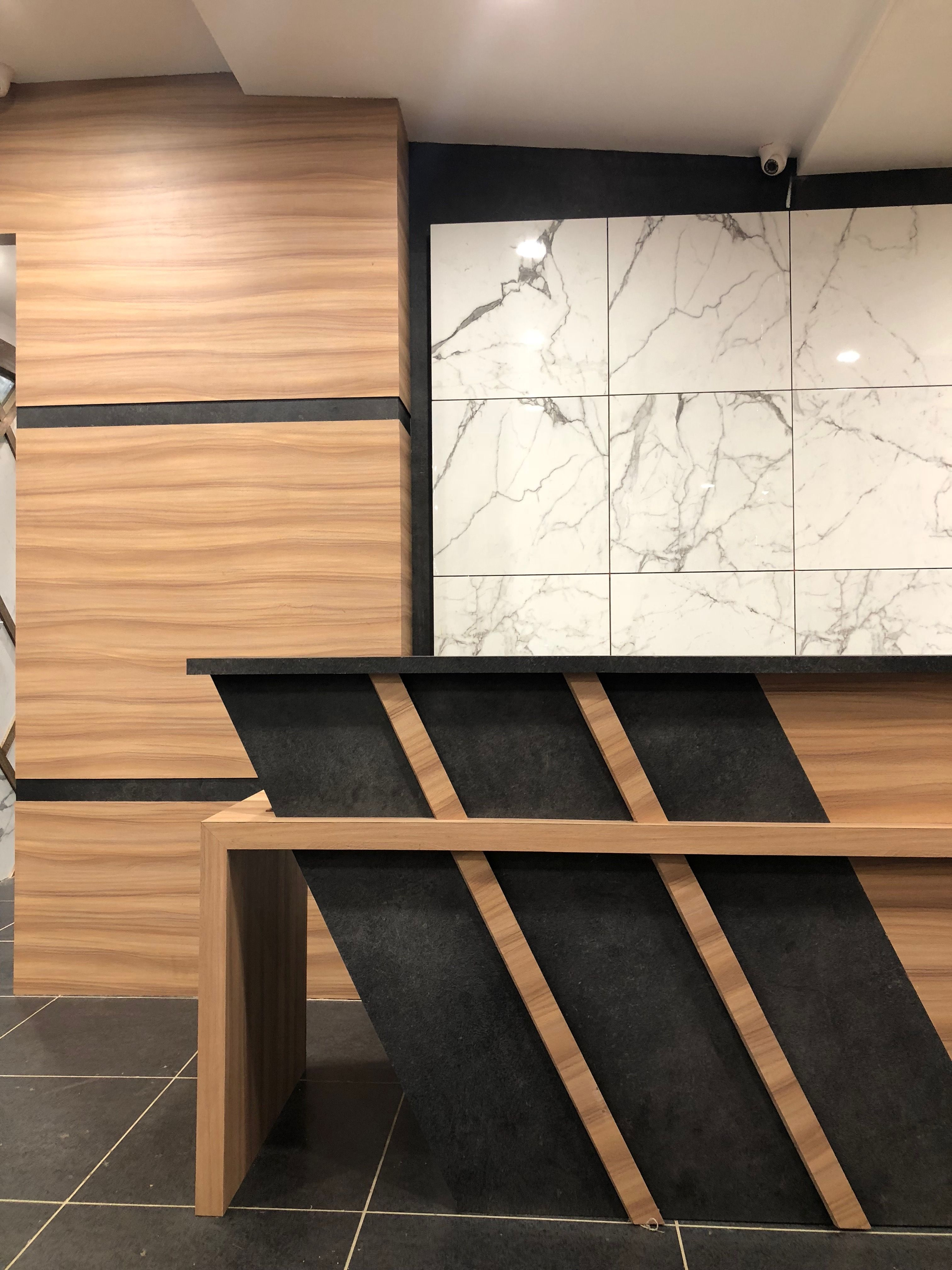 Reception#table#porcelain#tiles#woodenfinish#pattern#modern