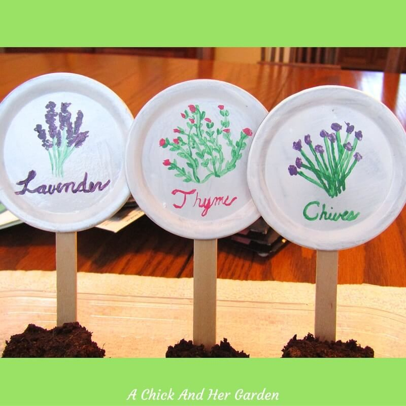 Put those old canning lids to work!!! Garden/plant markers