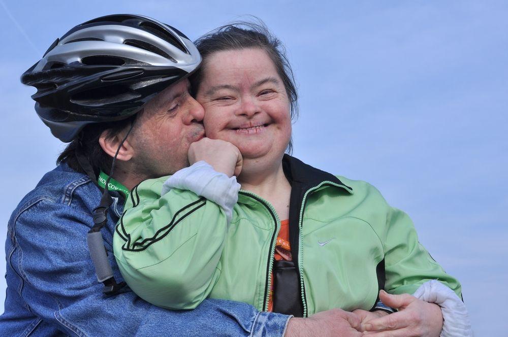 Down syndrome stock photos love family caregiver