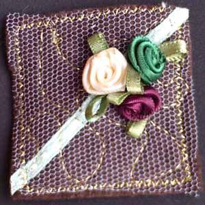 INCHIE: ribbon roses on brown felt inchie