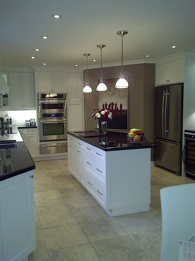 antique brown and white cabinets cream tile floor dark countertops rh pinterest ca