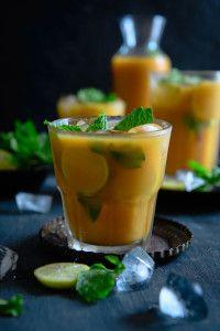 Mango puree - 1 cup Tea leaves - 3 tsp Water - 4 cups Sugar - 4 tsp Lemon juice - 6 tsp Mint leaves - 15-20 Ice cubes Lemon slices for garnishing