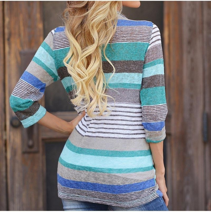 f339b4b6e9 A loose woven cardigan featuring long sleeves