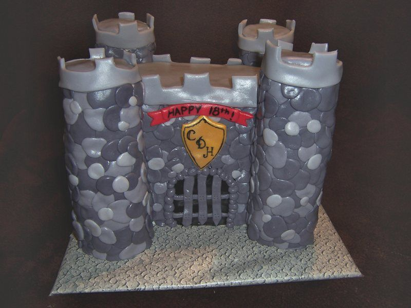 """Castle Cake - Chocolate cake with buttercream and fondant """"stones"""".  Turrets were made from Rice Krispie squares.  This cake took me SIX hours to make, even with my husband's help for 2 of those hours!  Never again!"""