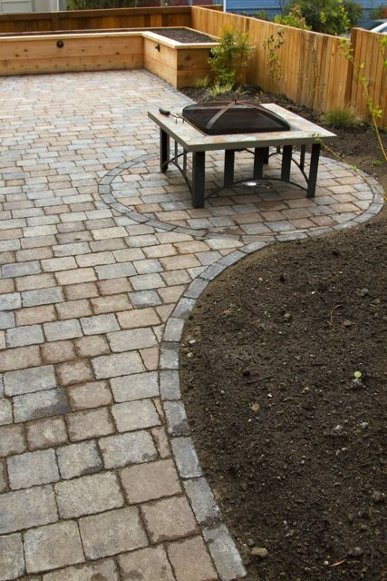 Landscaping With Stone Patio With Raised Garden Bed