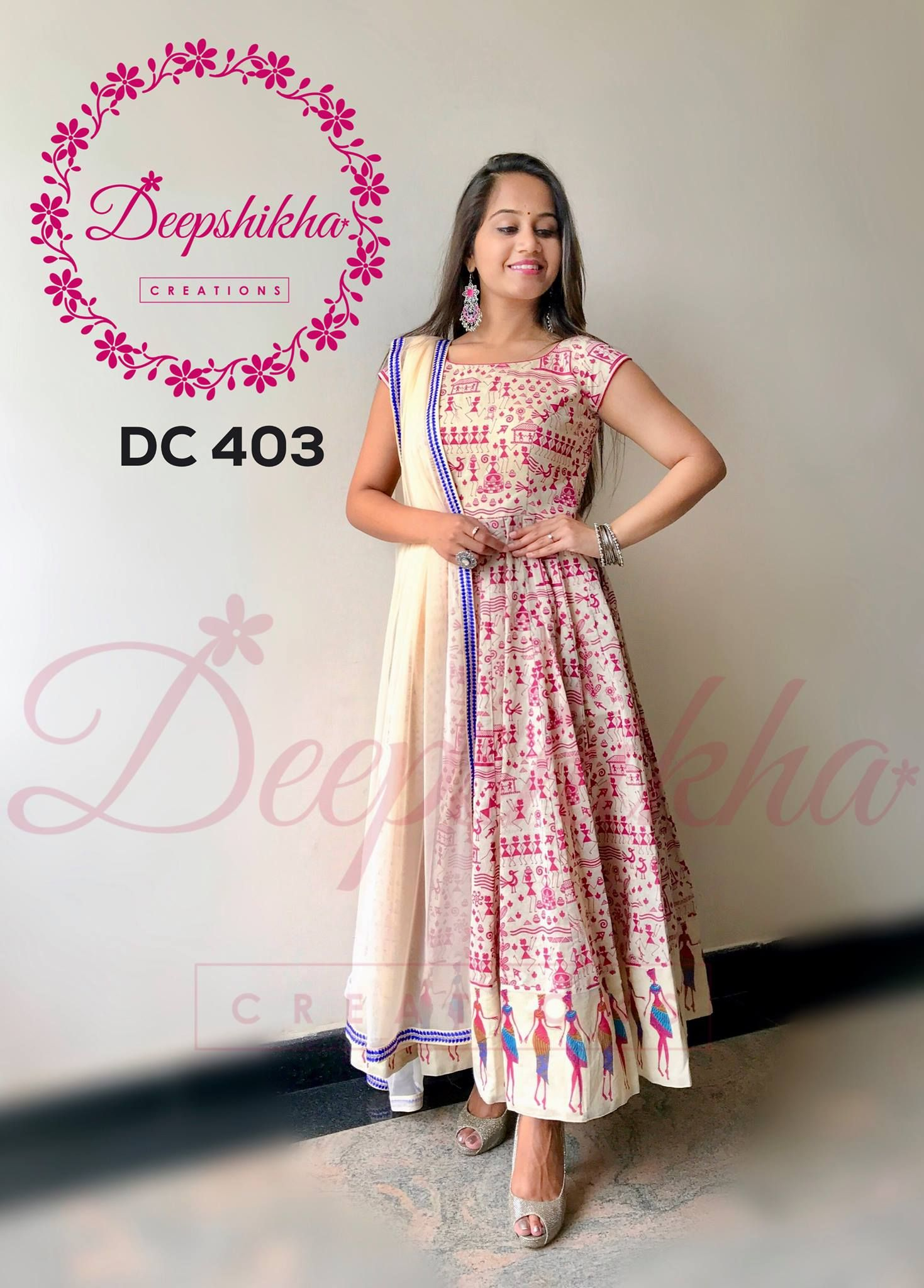 0471dcff694401 DC 403. Beautiful cream color floor length dress with dancing woman print.  For queries kindly whatsapp   +91 9059683293