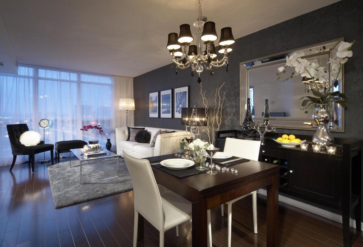 Dining room with black feature wall and chandelier, white ...