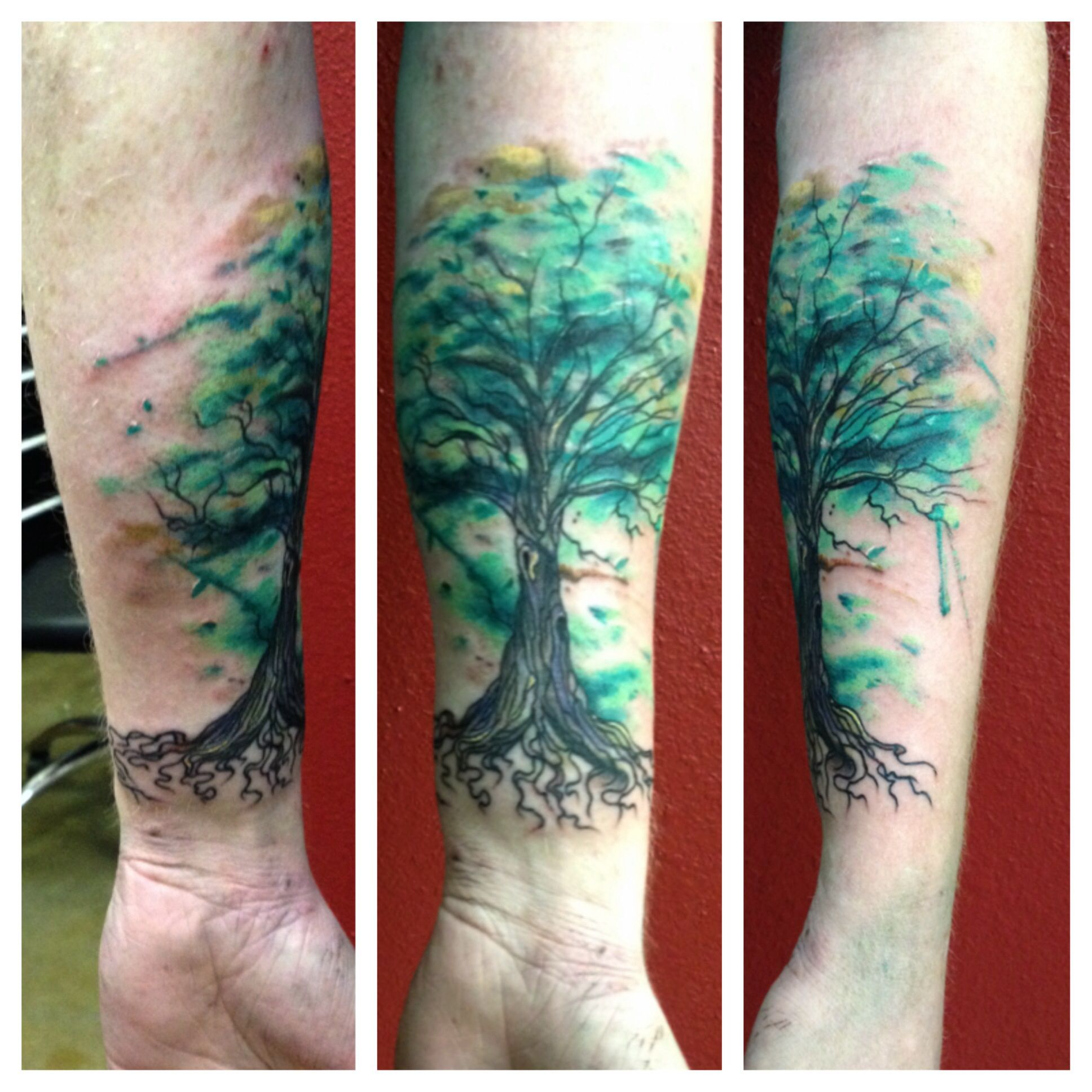 Watercolor abstract tree tattoo on forearm
