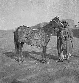 One of the preserved sets of Roman horse armor found in Tower 19, photographed on the back of a horse at the time of discovery (1932–1933)