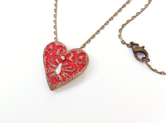 A romantic gift to give your loved one. A little red heart I've made out of paper pulp, painted with acrylic and metal colors and then sealed it with matte varnish for protection. It is durable and would last for many years. #1stAnniversary #Heartnecklace by Dafna Yarom