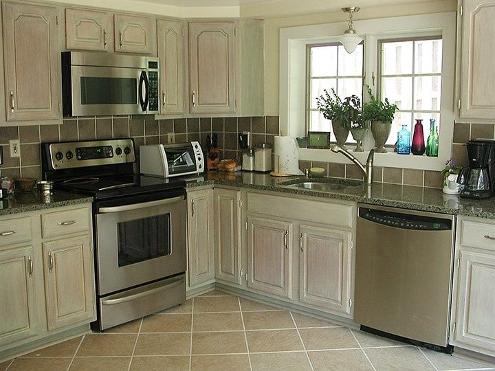 Whitewashed kitchen cabinets can dramatically change the ...