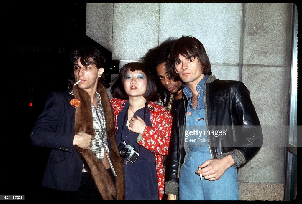Group portrait of, from left, musician Johnny Thunders (born John Genzale Jr, 1952 - 1991), band manager and photographer Anya Phillips (1955 - 1981), and musicians Buddy Bowser and Dee Dee Ramone (born Douglas Colvin, 1951 - 2002), New York, New York, 1975.