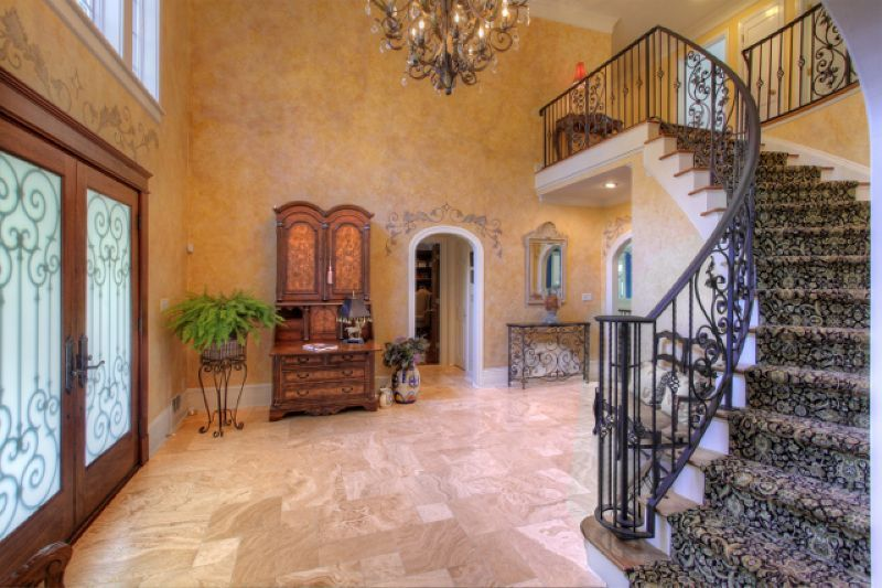 European colonial with Tuscan inspired design. Private drive leads to wooded acreage opening to beautiful custom home