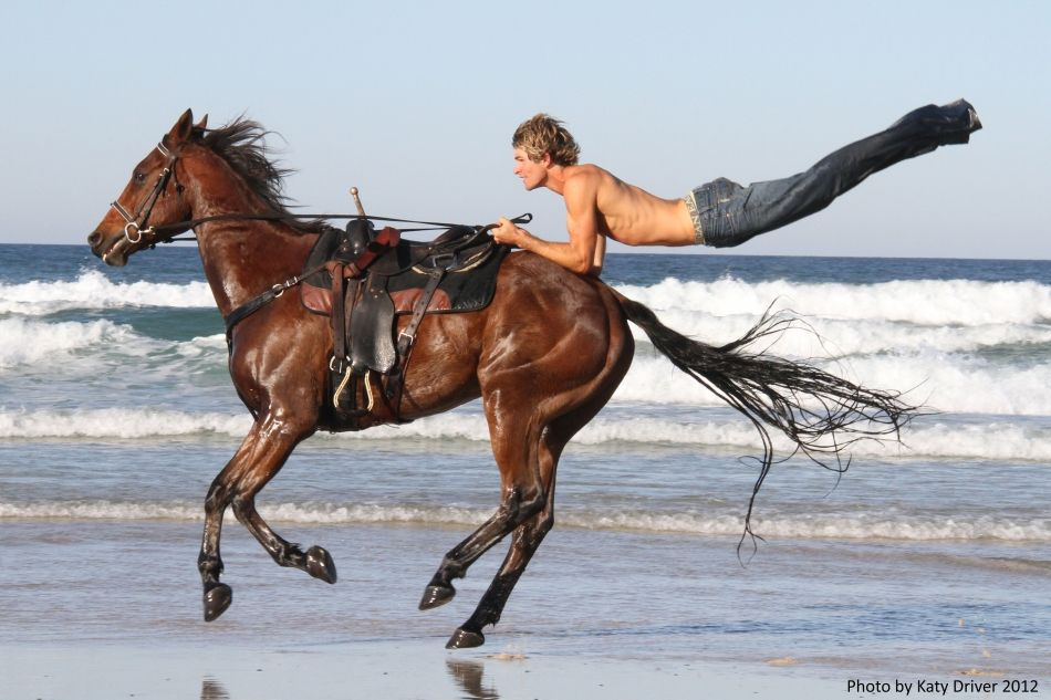 Trick horse rider--okay, so this doesn't quite fit the category but look at the muscles and fitness on both fine animals!