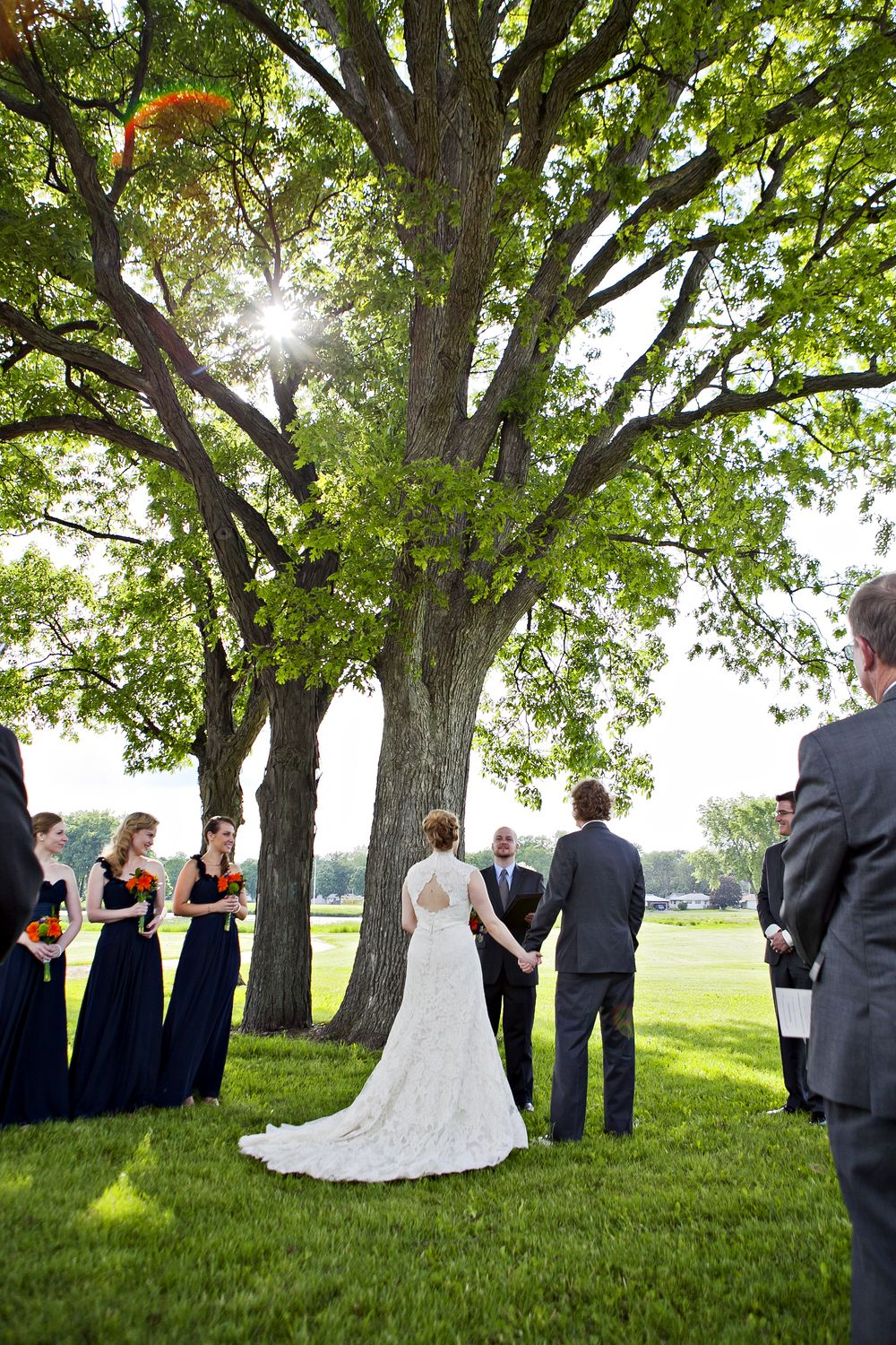 outdoor wedding // Madison, WI // bride and groom ceremony picture // couple wedding photos // outdoor wedding ceremony