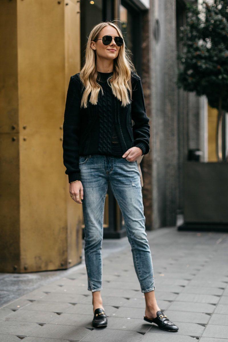 35072bc80ec4 Blonde Woman Wearing Black Sweater Denim Jeans Outfit Frame Black Cable Knit  Sweater Denim Split Hem Skinny Jeans Gucci Loafer Mules Celine Aviator ...