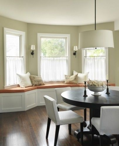 wall color, light fixture, black round table, light chairs, light window coverings