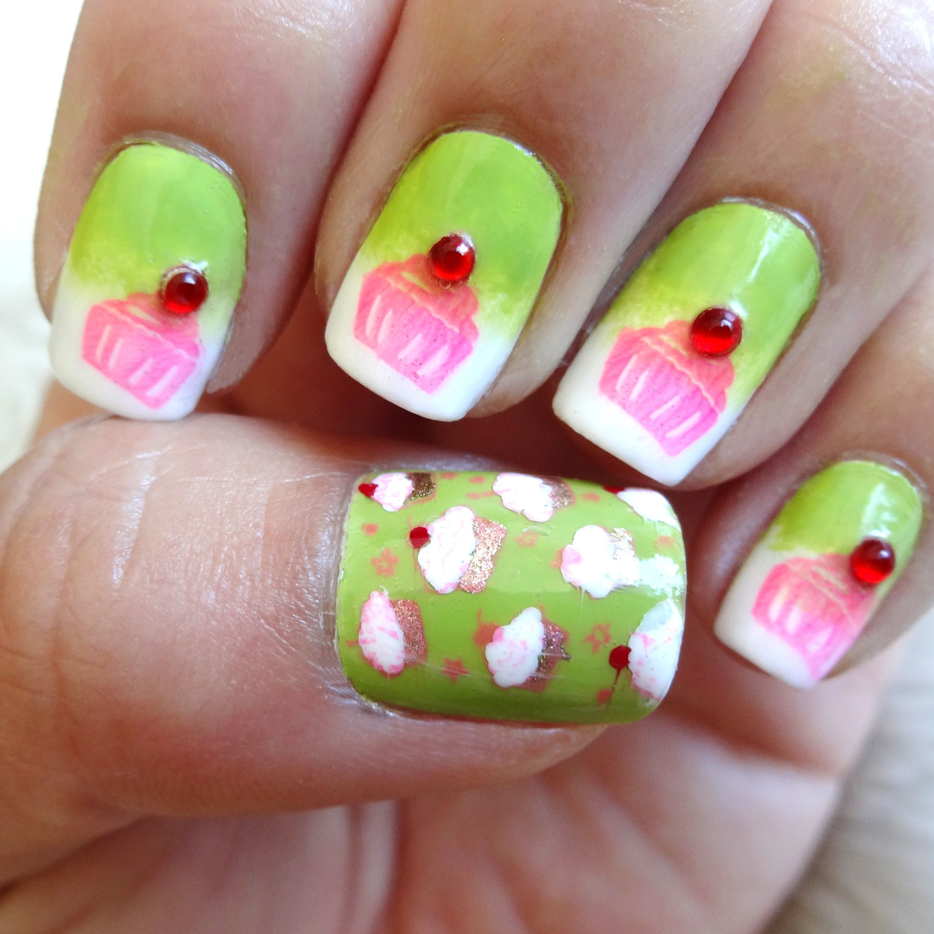 """Cupcake Nail Art. Used Bundle Monster stamping plates BM-H20 and BM14. Polishes used are Sally Hansen """"Green With Envy"""" and Sinful Colors """"Cream Pink."""" #nailart"""