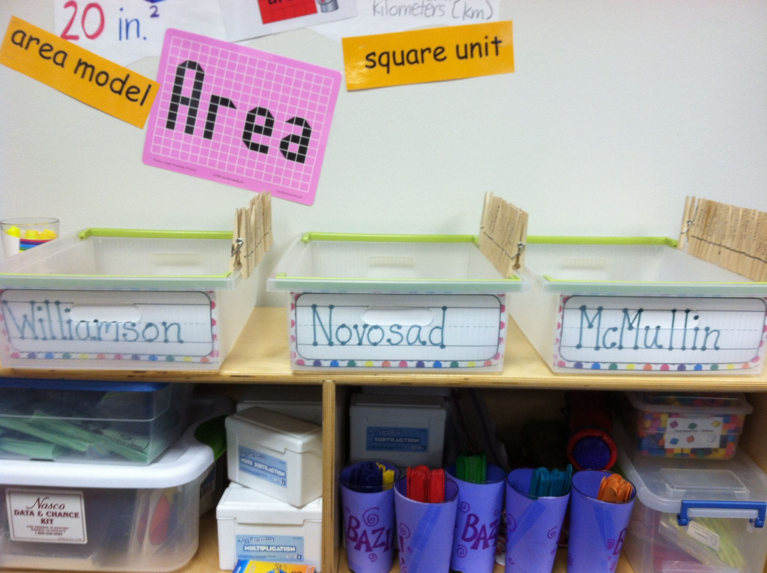 Homework Tubs- The clothes pins have each students' name on them, before class starts they pin their homework and place it into their homeroom tub. Makes it easy to see who hasn't turned in their hw with a glance. (AM MEFB 352-503)