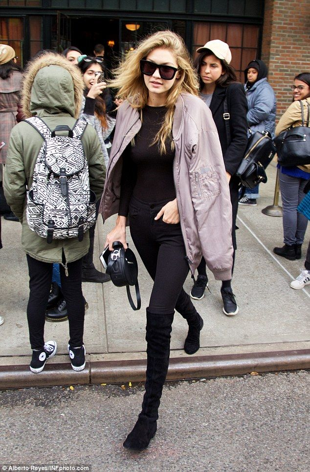 3f85b2bd969 Gigi Hadid covers up in purple jacket while stepping out in windy ...