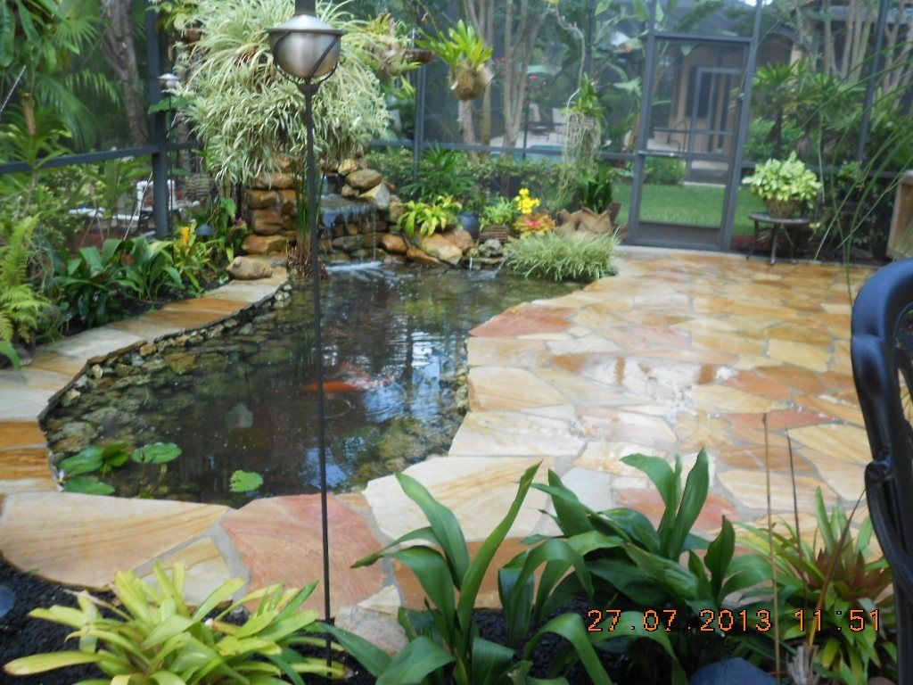 Koi pond and flagstone patio 72 flagstone patio pond for Swimming pool koi pond conversion