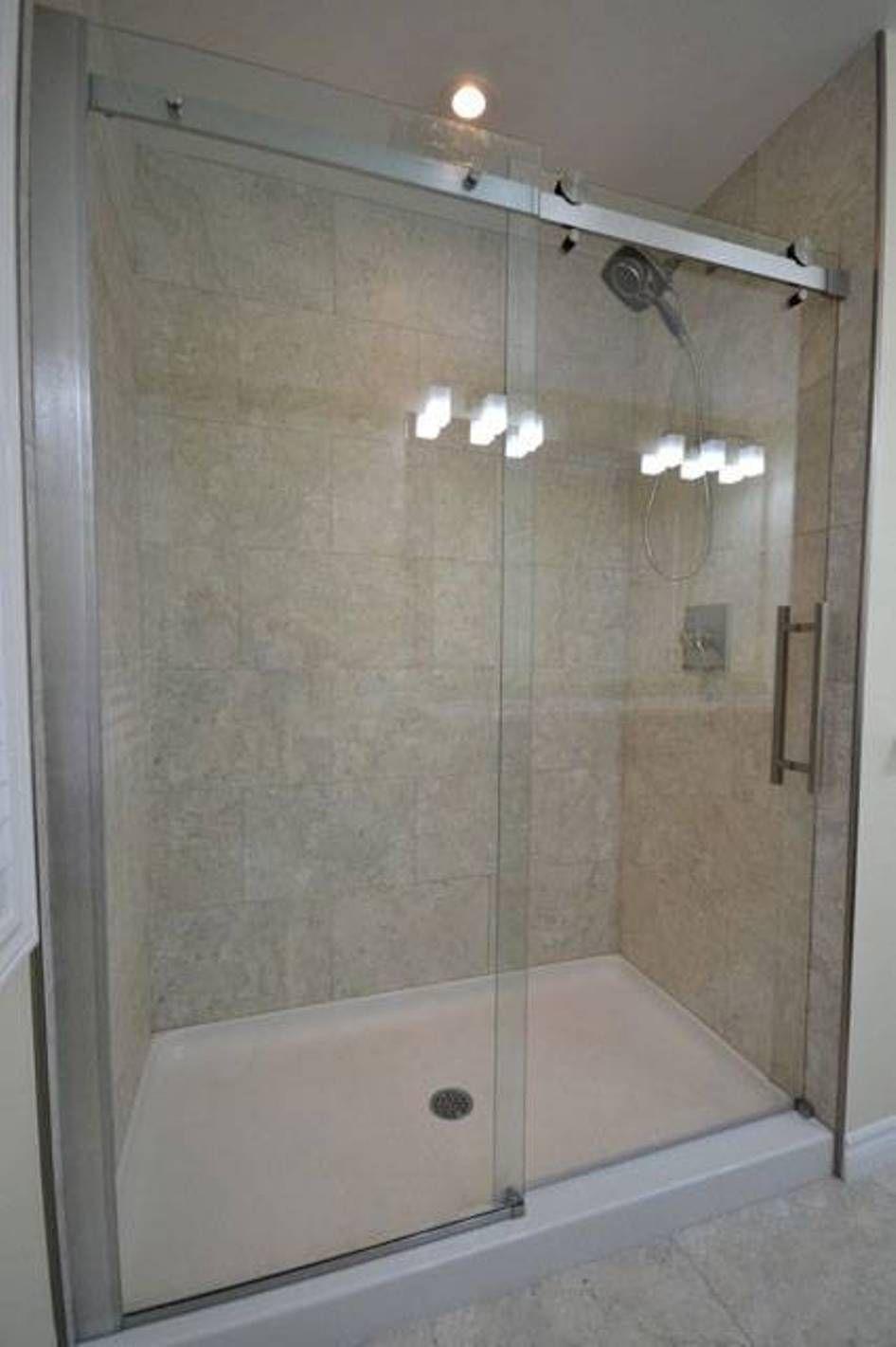shower pan with sliding glass door in bathroom  Bathroom