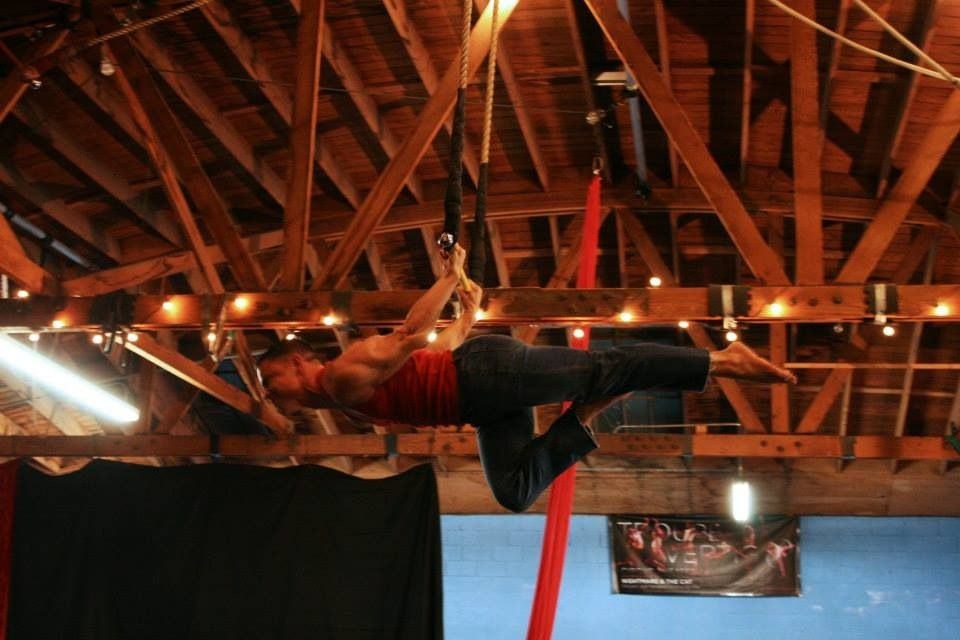 Doing the planche (back lever) during the Cirque School teacher performance.