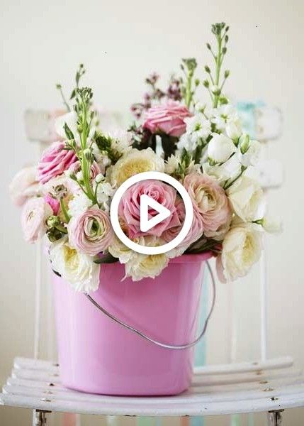 Boyer OK so I know this is pink but if you were looking for a fairly cheap and cute way to have flowers we could find all pails, tins, and watering cans and spray paint them yellow or white or some fun design combo and place them around.@Alyson Boyer OK so I know this is pink but if you were looking for a fairly cheap and cute way to have flowers we could find all pa...