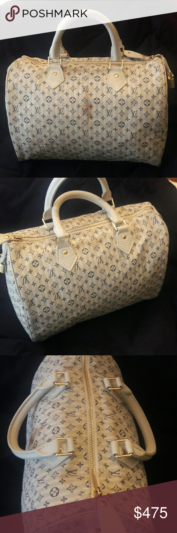 Louis Vuitton Speedy 30 Authentic in Pre-owned Condition has a  stain on the front checkout all pictures I haven't tried to clean. Light blue on white monogram cowhide leather handles. Comes with lock, keys and lv charm. Sorry no dust bag. Louis Vuitton Bags Satchels