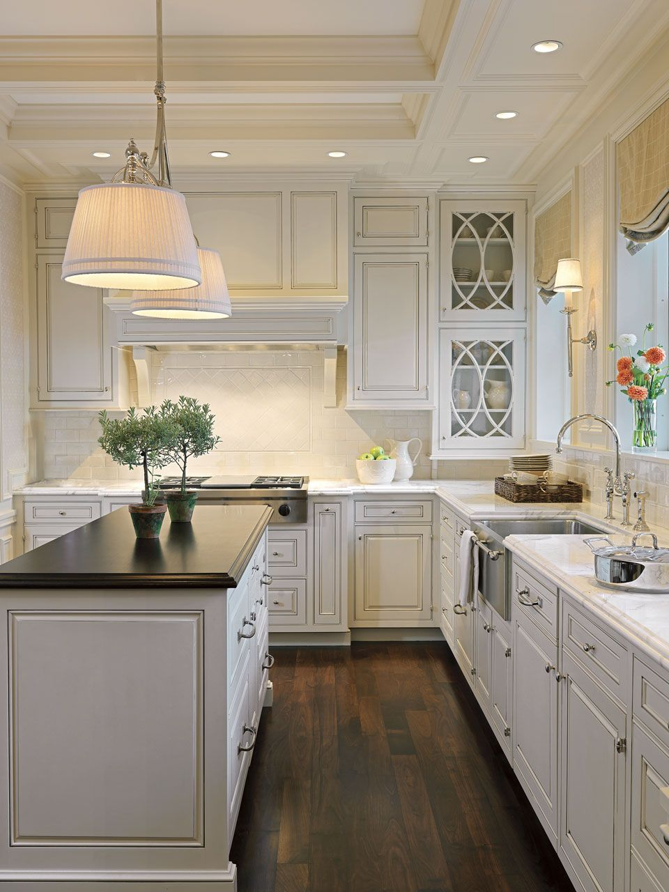 Window kitchen cabinet doors  a window above the sink looking out to a big back yard a forest of