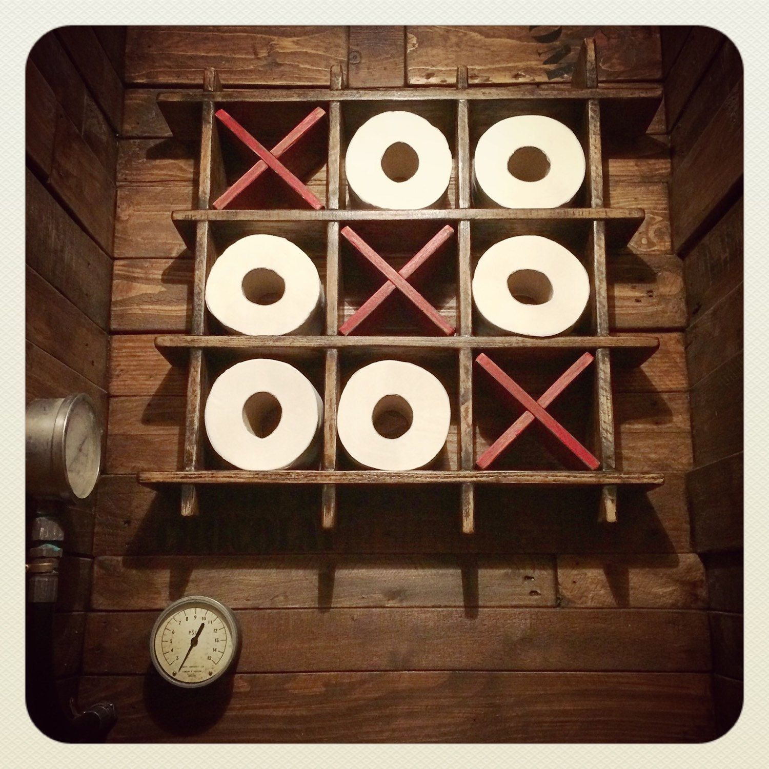 This Toilet Roll Holder Rack In A Tic Tac Toe Style Will