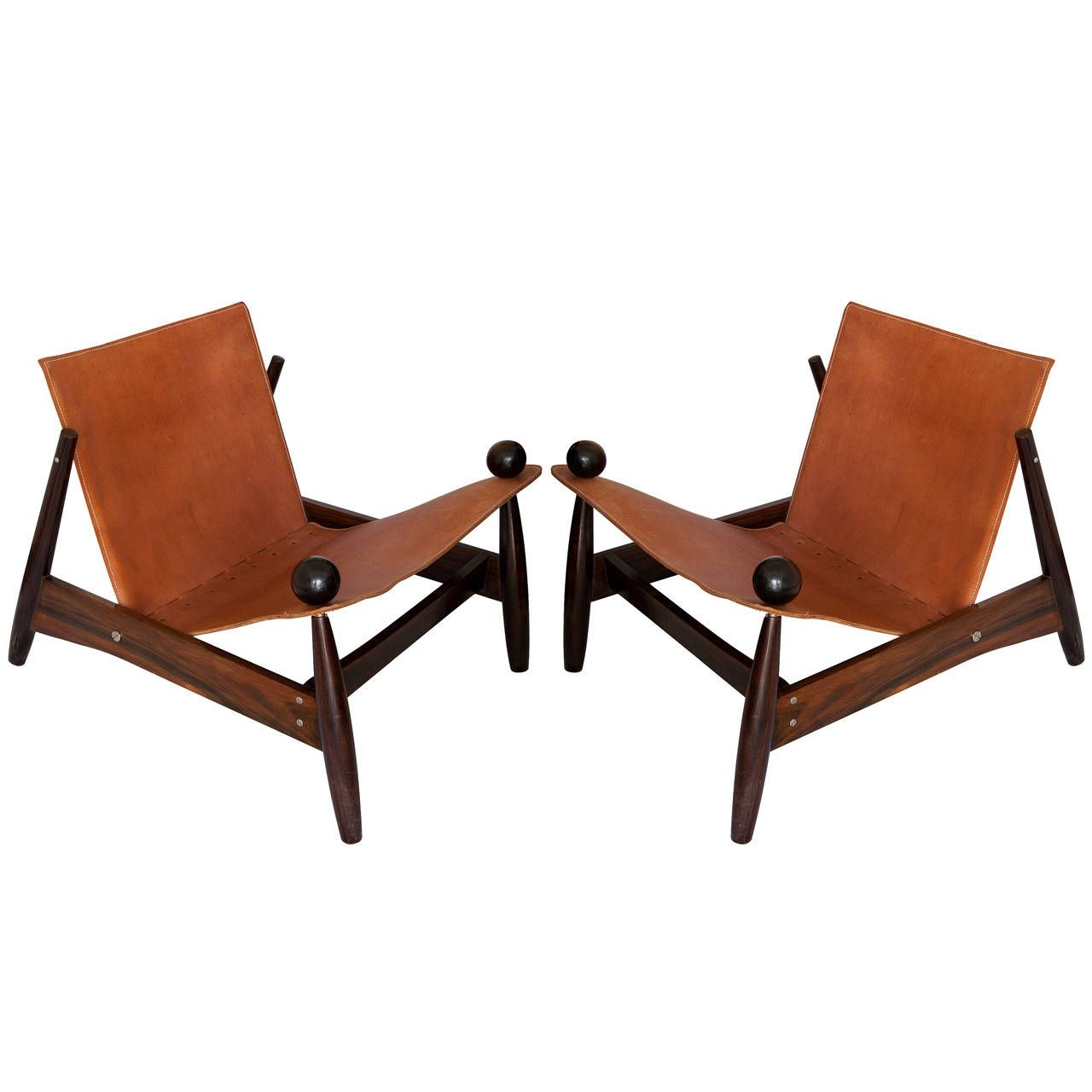 Jacaranda and leather lounge chairs, designer not identified.