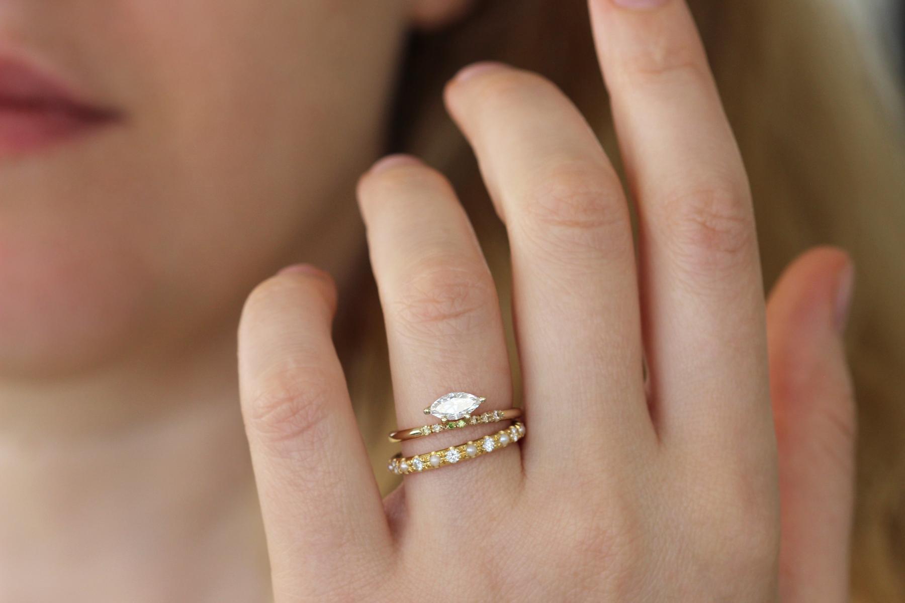 0.5 carat marquise diamond ring on finger Wedding ring