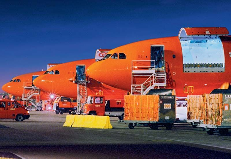 55c848b11abead TNT cargo planes and ground vehicles ready for loading