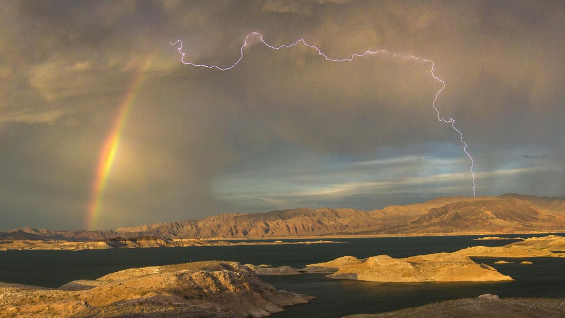 Nevada storm Allen Schaben / Los Angeles Times LAKE MEAD, NEV. -- WEDNESDAY, JULY 1, 2015: Lighting and rainbow form overLake Mead National Recreation Area in Nevada Wednesday, July 1, 2015. Thestorm brought very little rain to the lake, which is at a historic low.(Allen J. Schaben / Los Angeles Times)