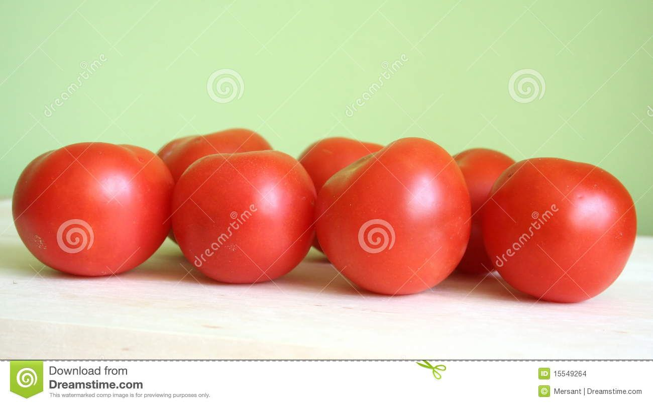 Some tomatoes with green background